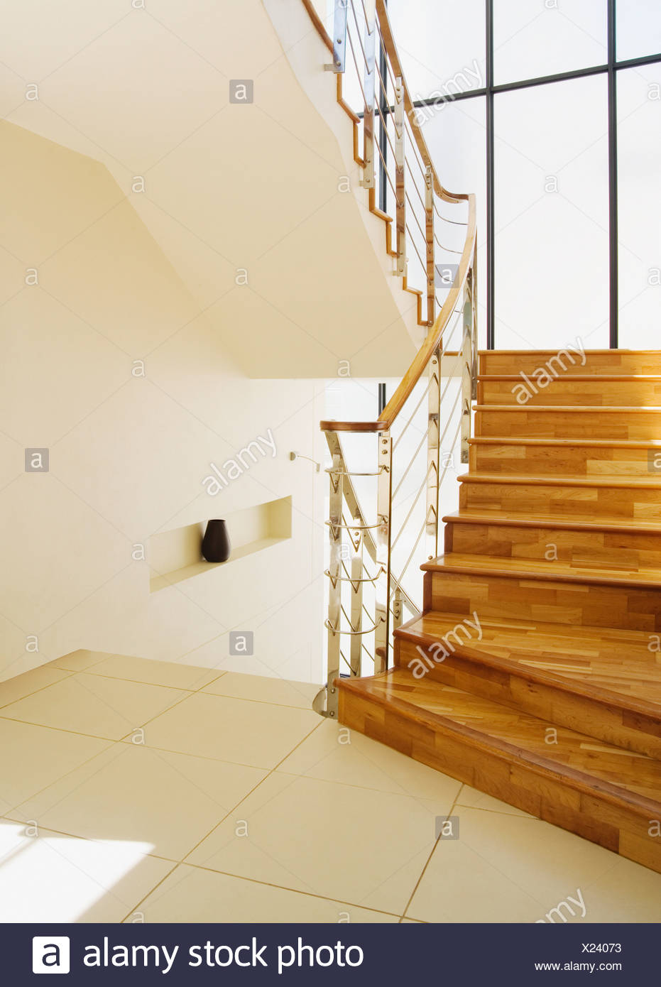 Modern stairs with large windows at landing - Stock Image
