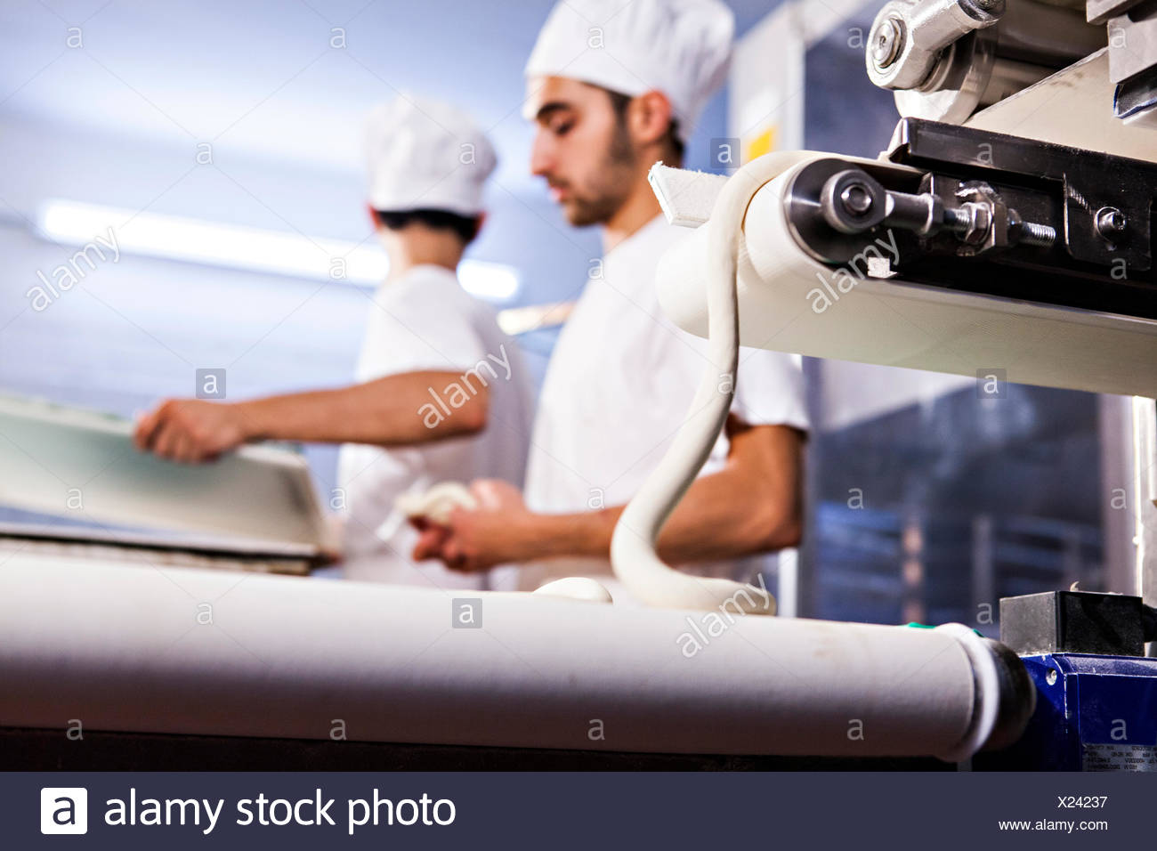 Bakers making pastry dough - Stock Image