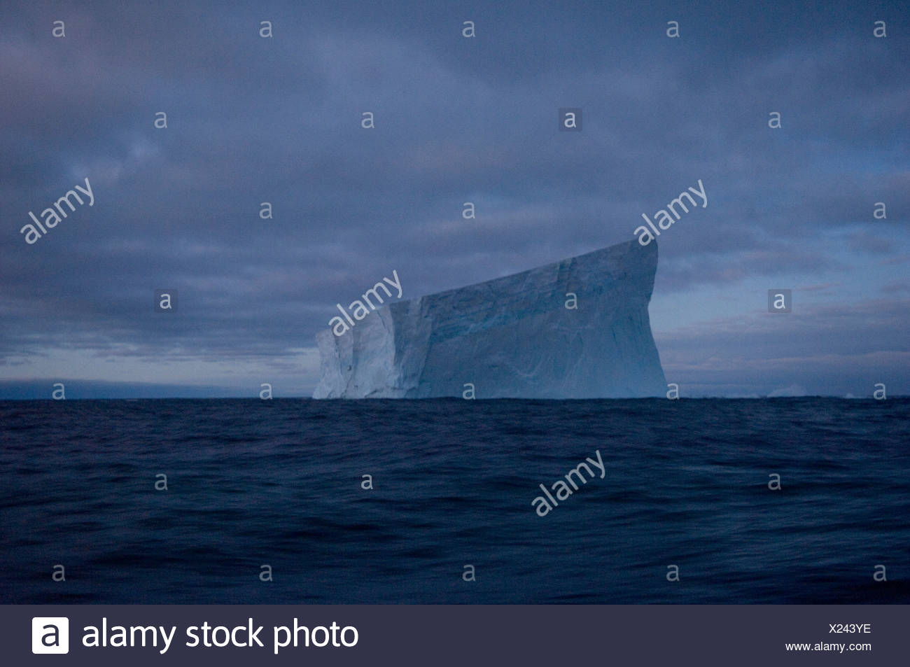 Ice floats off of the waters of Antarctica. - Stock Image