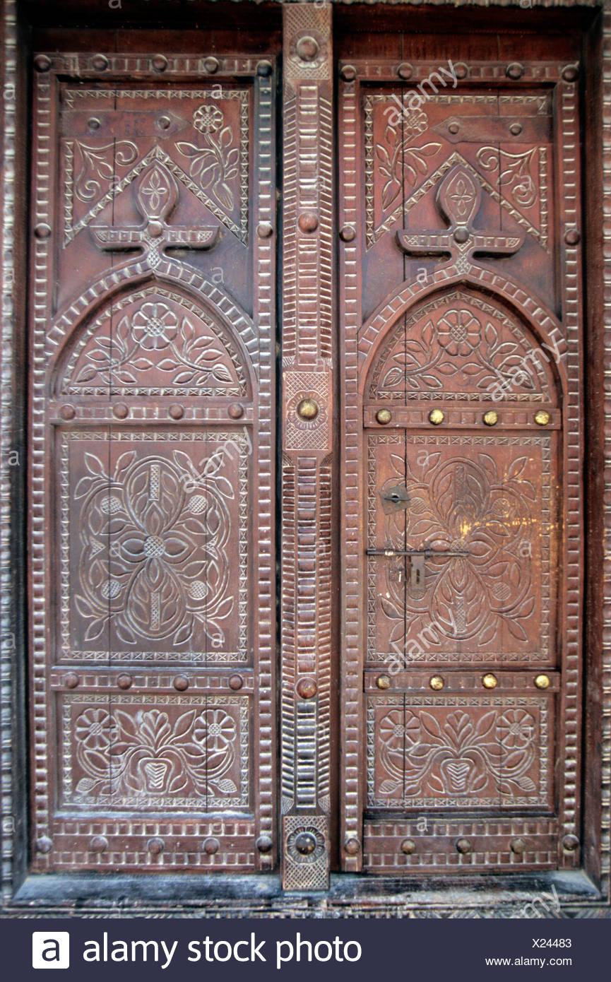 Ornate old wooden house door in Nizwa, Oman, Arabian Peninsula, Middle East Stock Photo