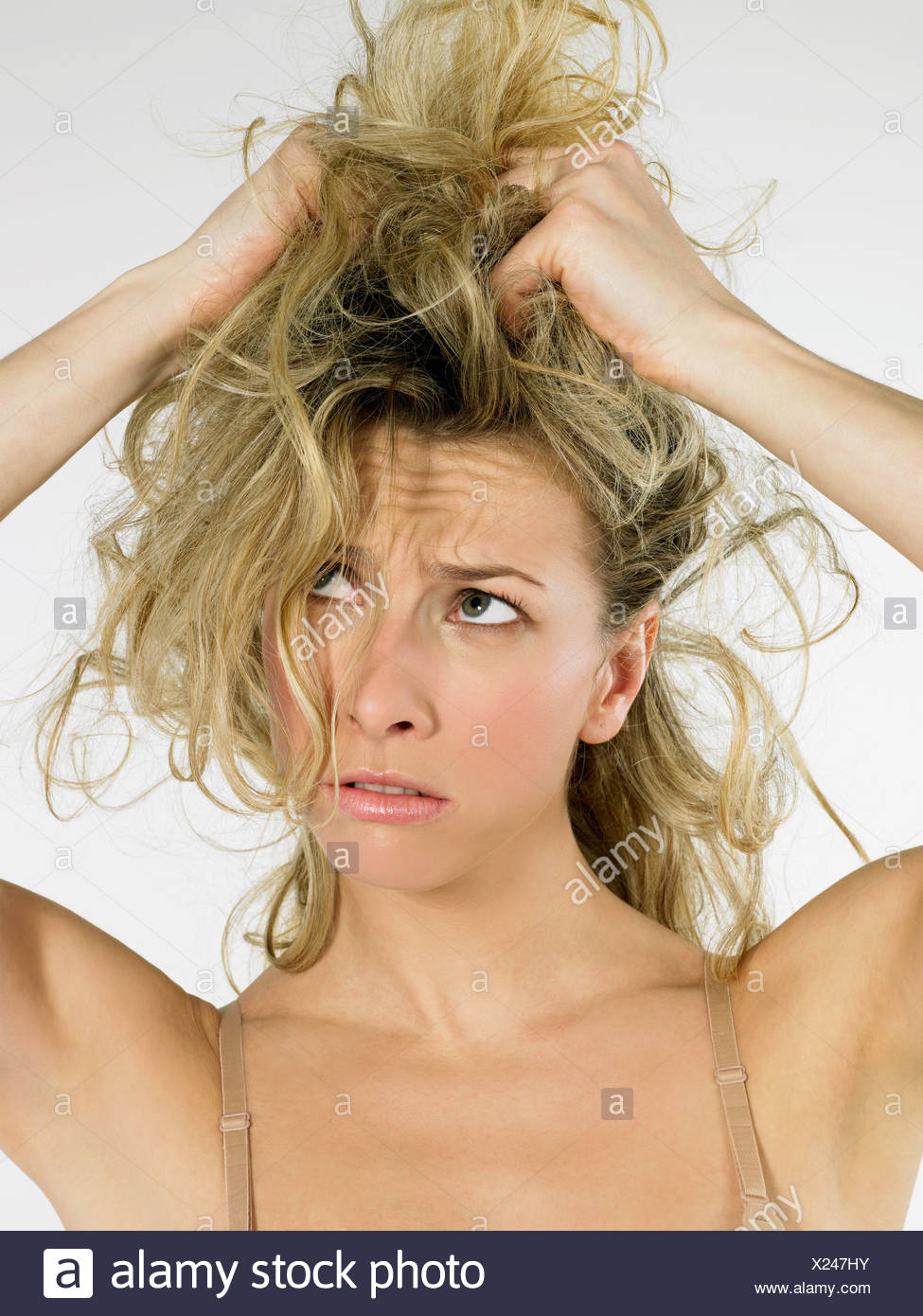 Woman with messy hair - Stock Image