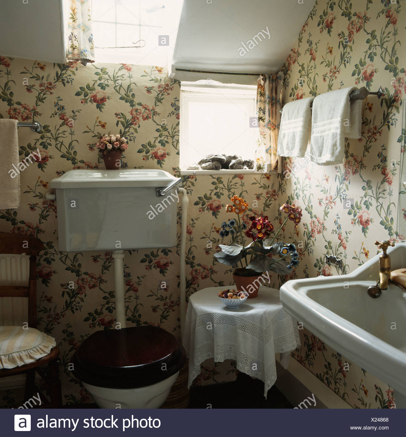 Country Cottage Bathroom With Floral Wallpaper Stock Photo