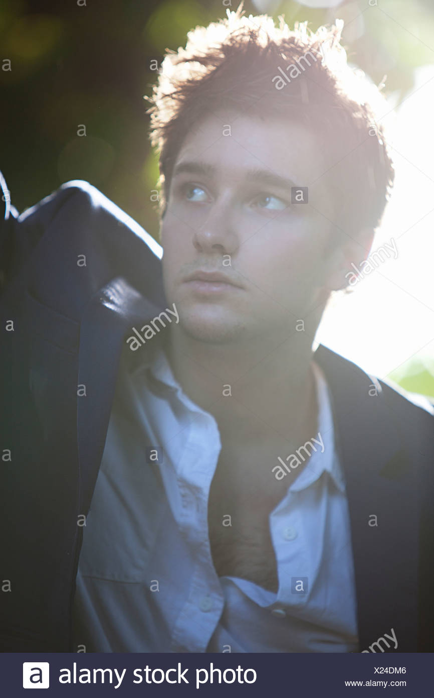 Close up of man standing outdoors - Stock Image