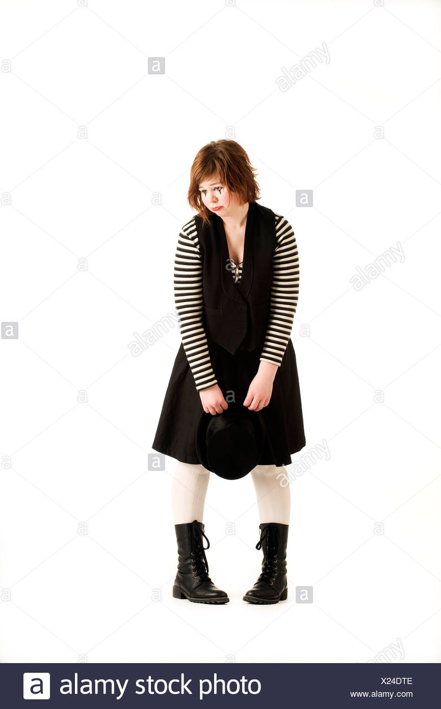Teenage girl dressed up as a clown. - Stock Image