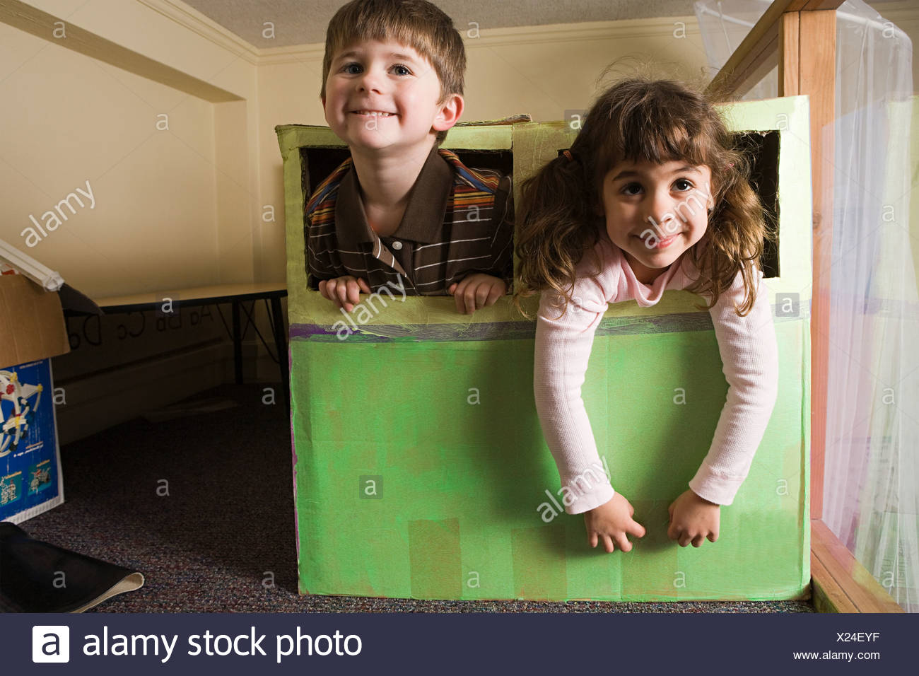 Children playing in a box Stock Photo