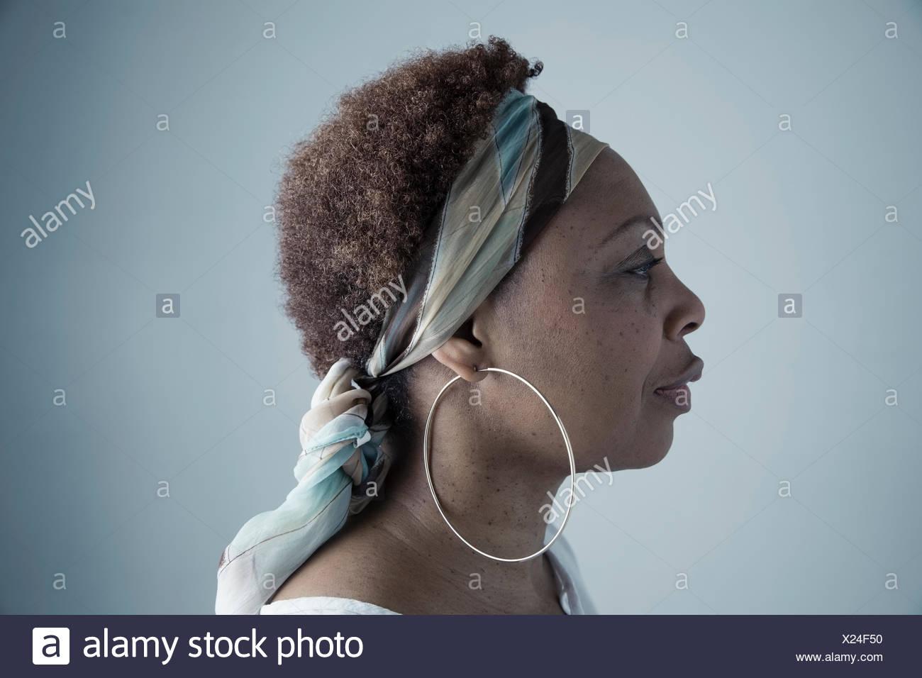 e32de32709570 Profile portrait serious African American mature woman wearing ...