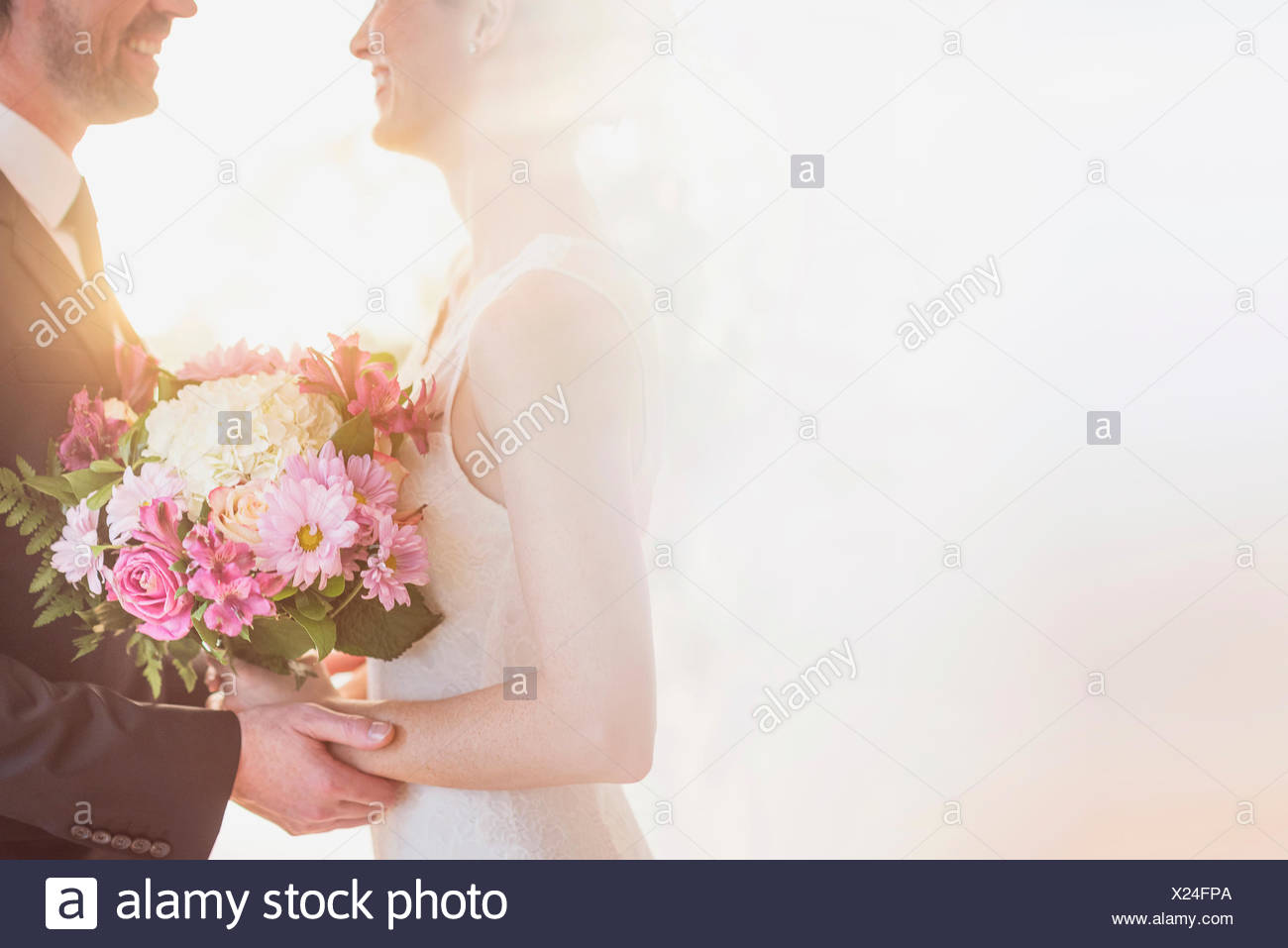 Bride and groom celebrating their wedding - Stock Image
