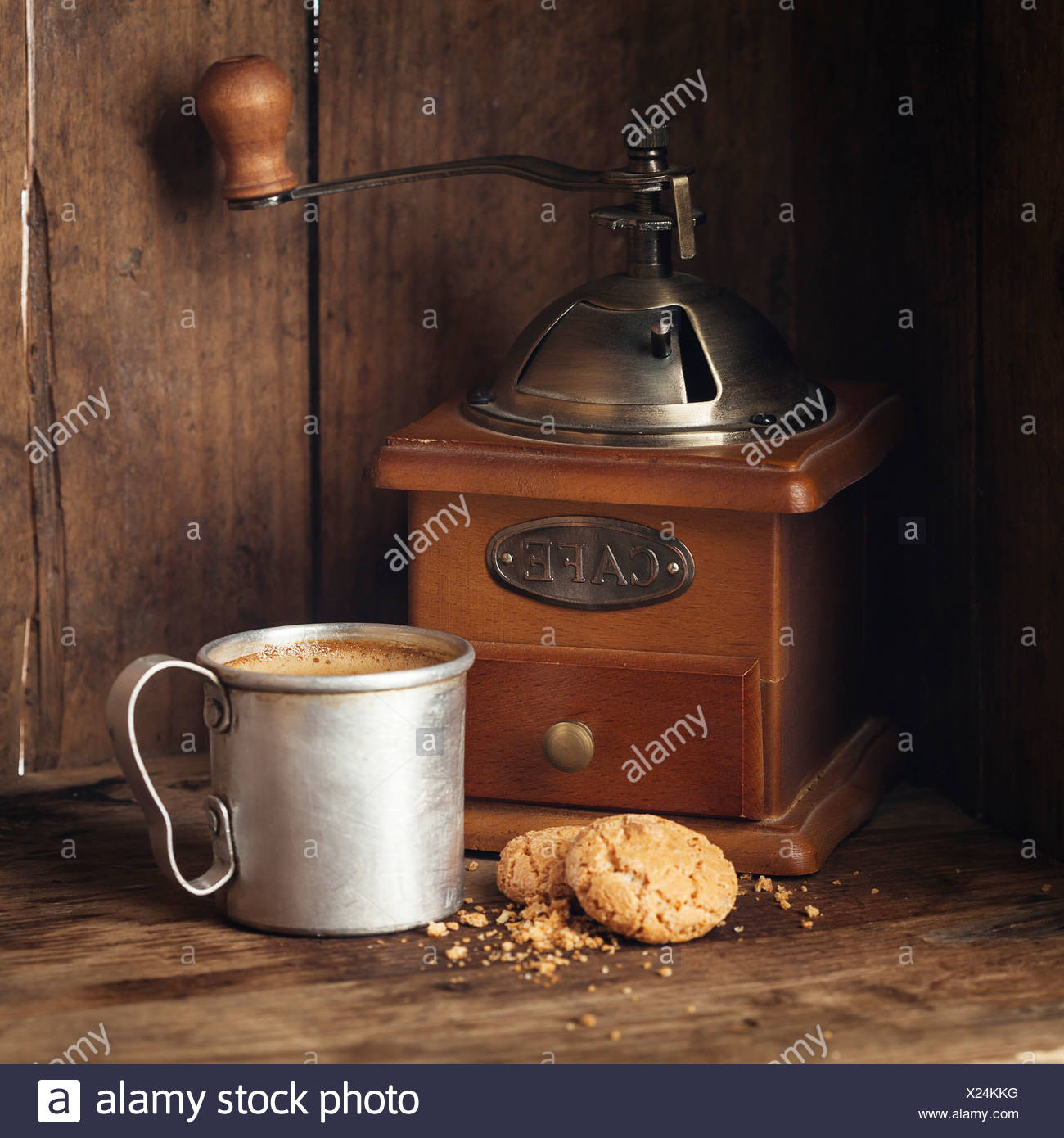 Coffee in aluminum mug with amaretti biscuits - Stock Image