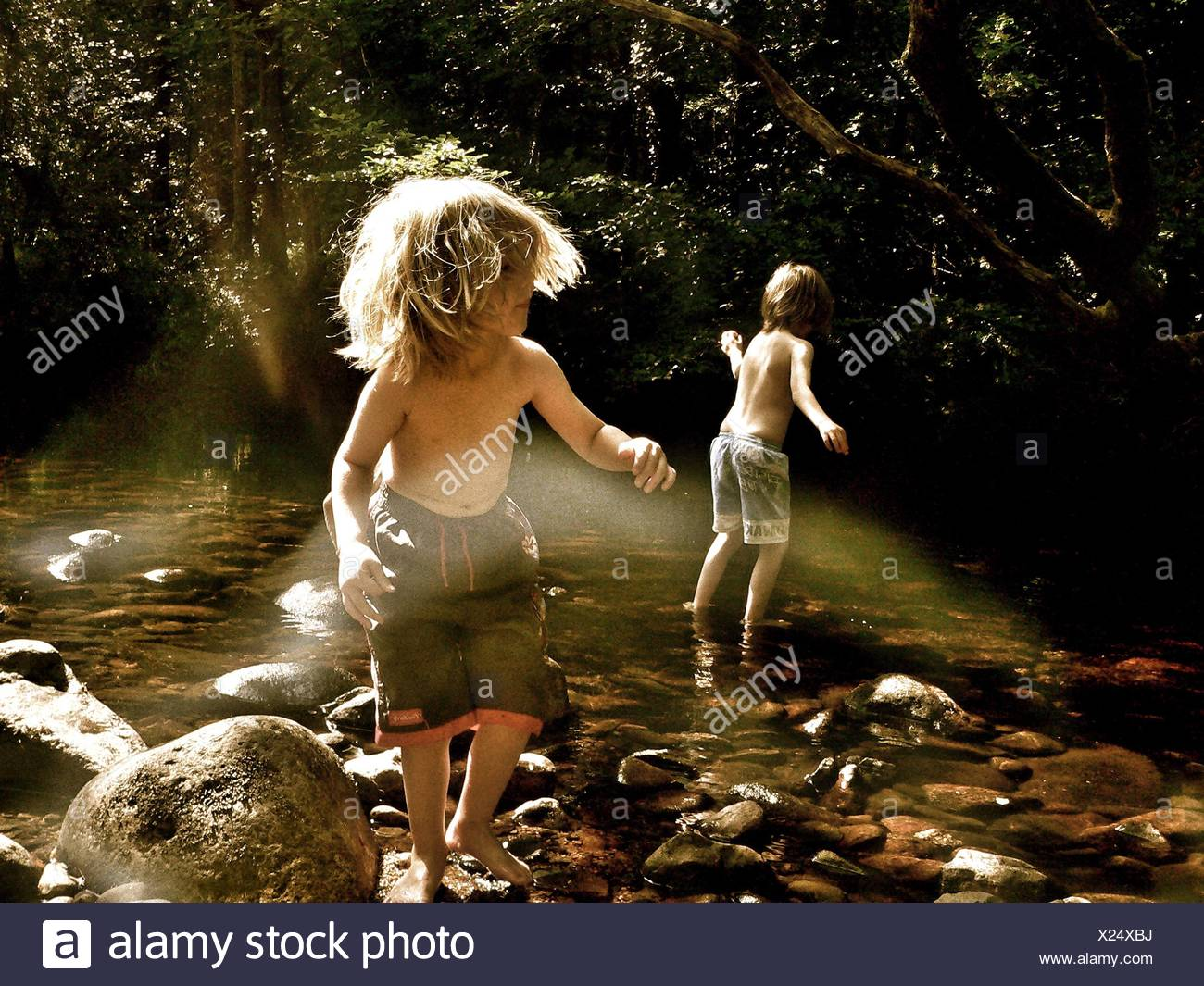 Boys Playing In Stream - Stock Image