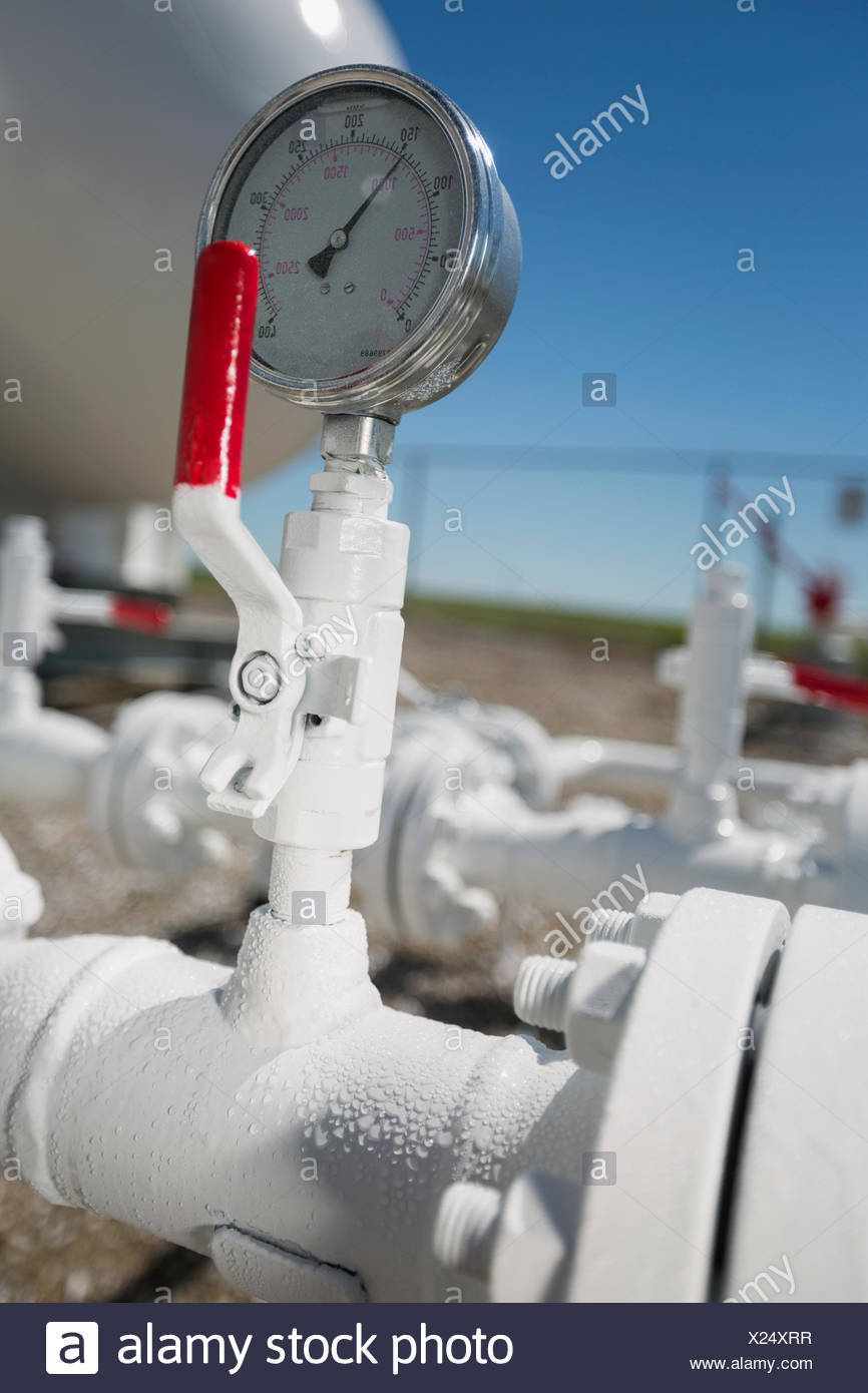 Natural gas pipe and gauge - Stock Image