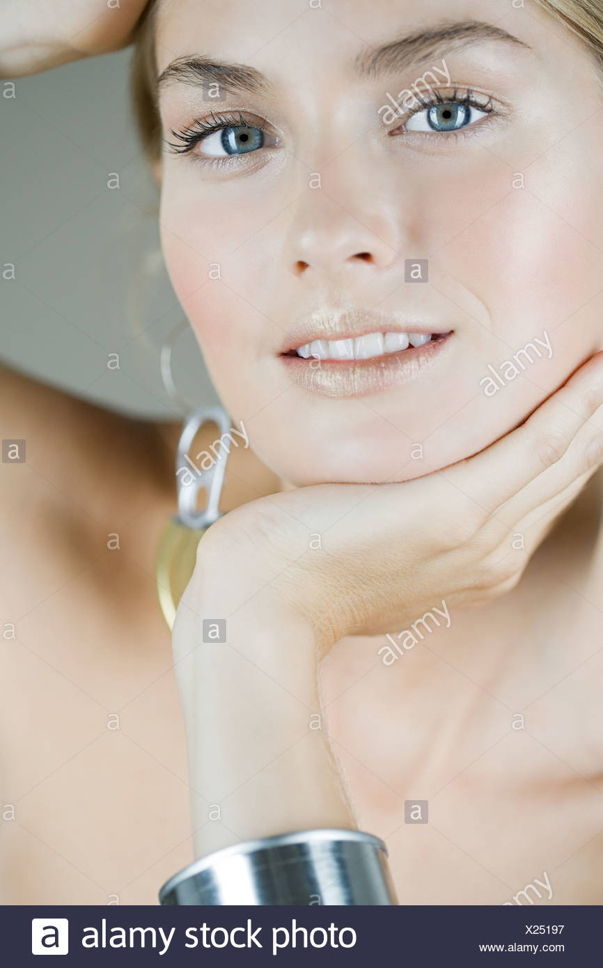 Portrait of a woman wearing recycled accessories - Stock Image