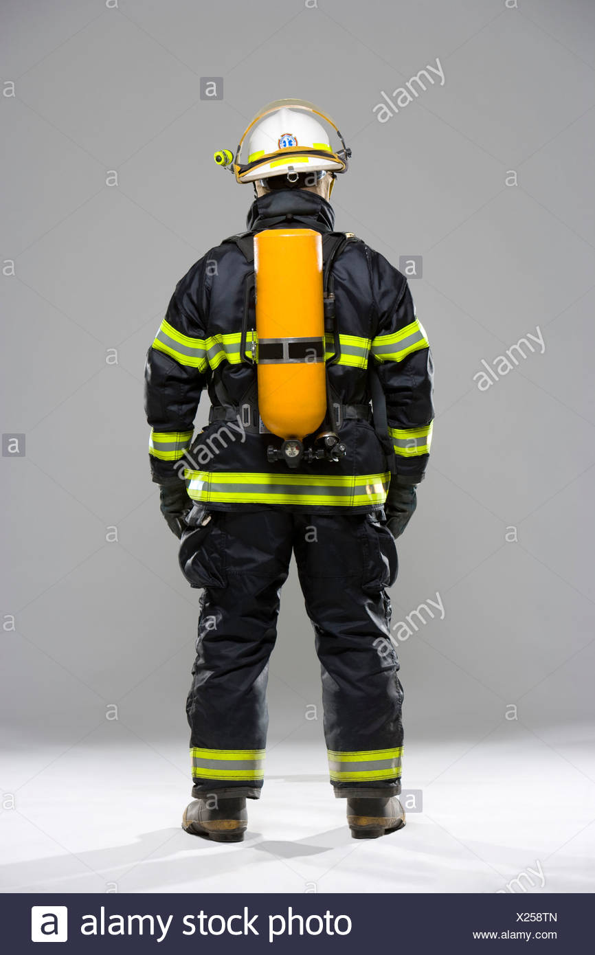 Backside of a firefighter - Stock Image