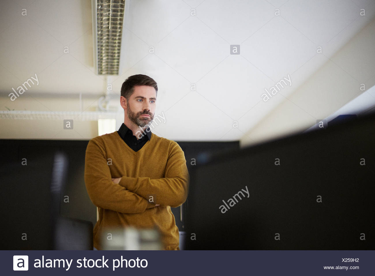 Casual businessman in office - Stock Image