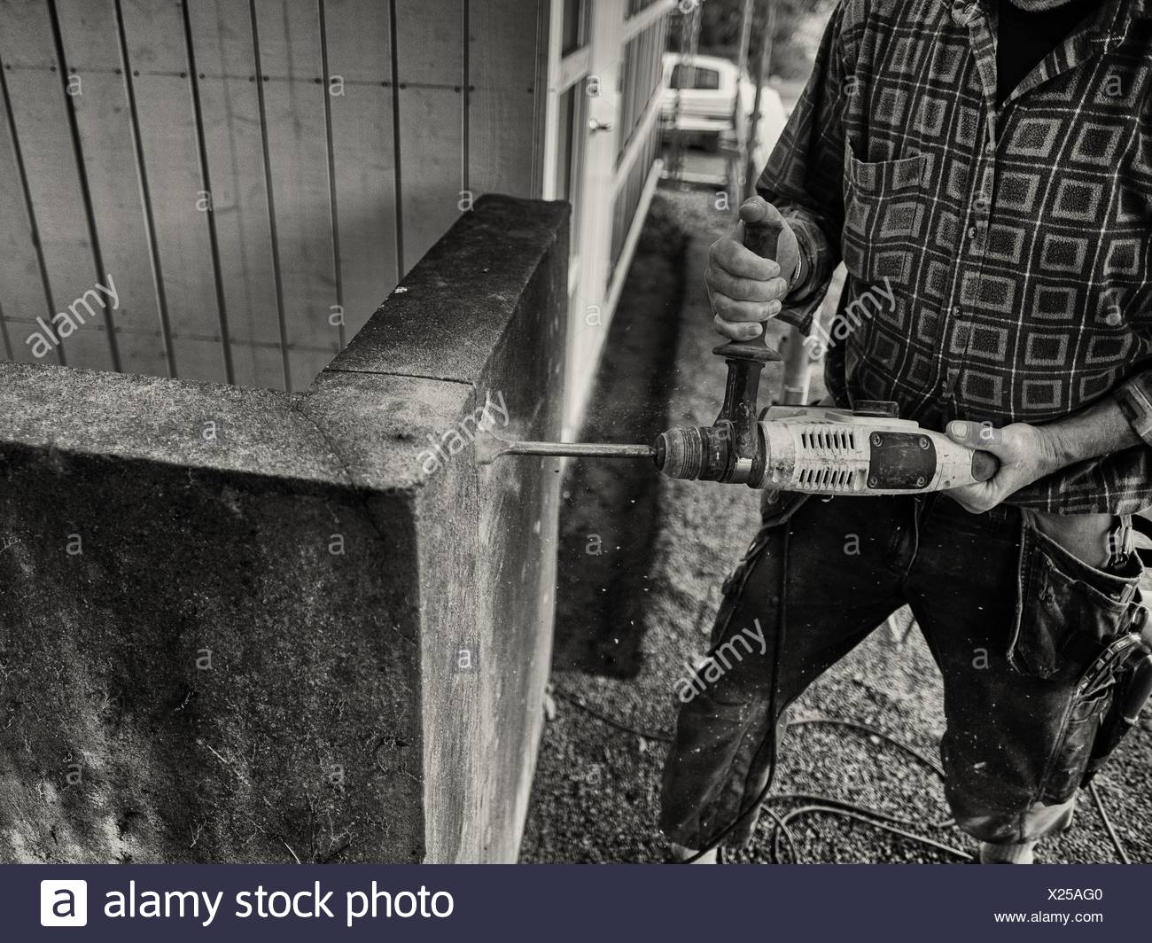 Midsection Of Man Cutting Stone From Hand Tool - Stock Image