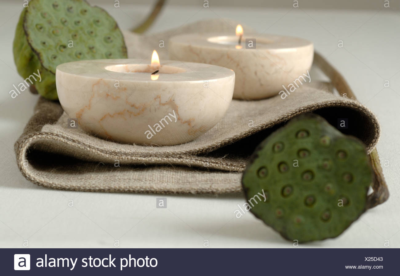 candle holders and lotus flowers - Stock Image