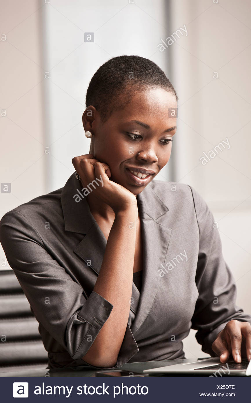 Young businesswoman working at desk Stock Photo