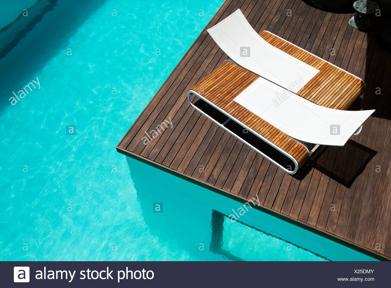 Lounge Chairs At Luxury Poolside