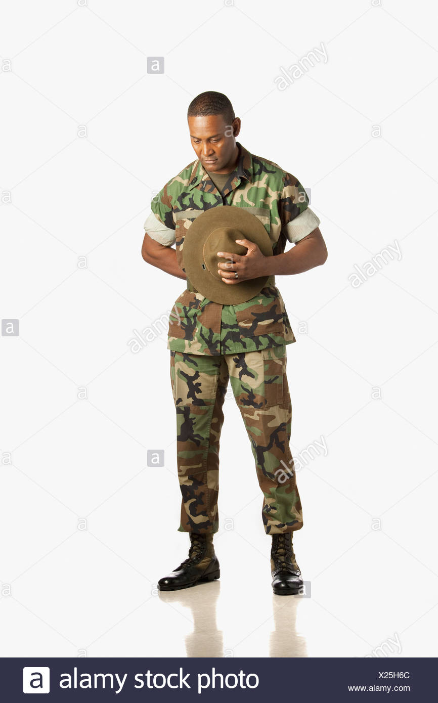 A Military Man With His Head Bowed In Prayer - Stock Image