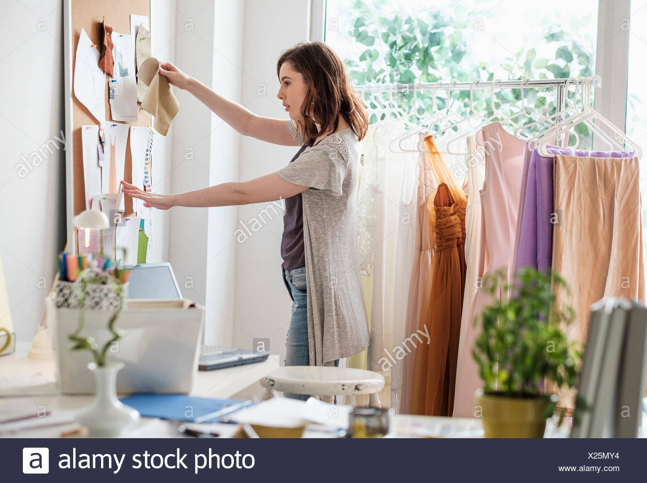 Female fashion designer in her office - Stock Image