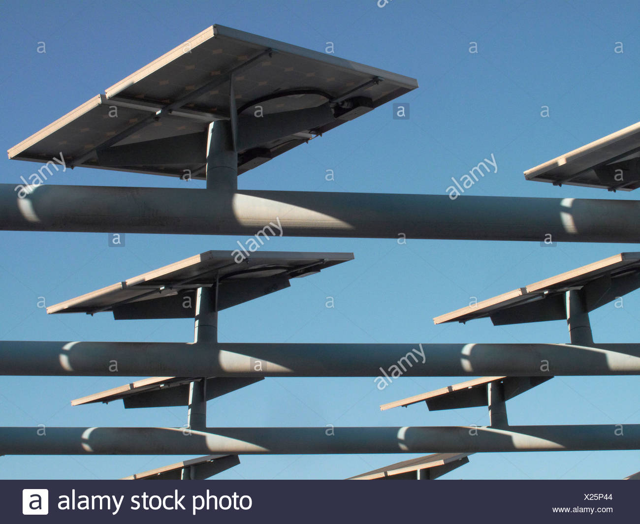 Solar panels mounted on roof - Stock Image