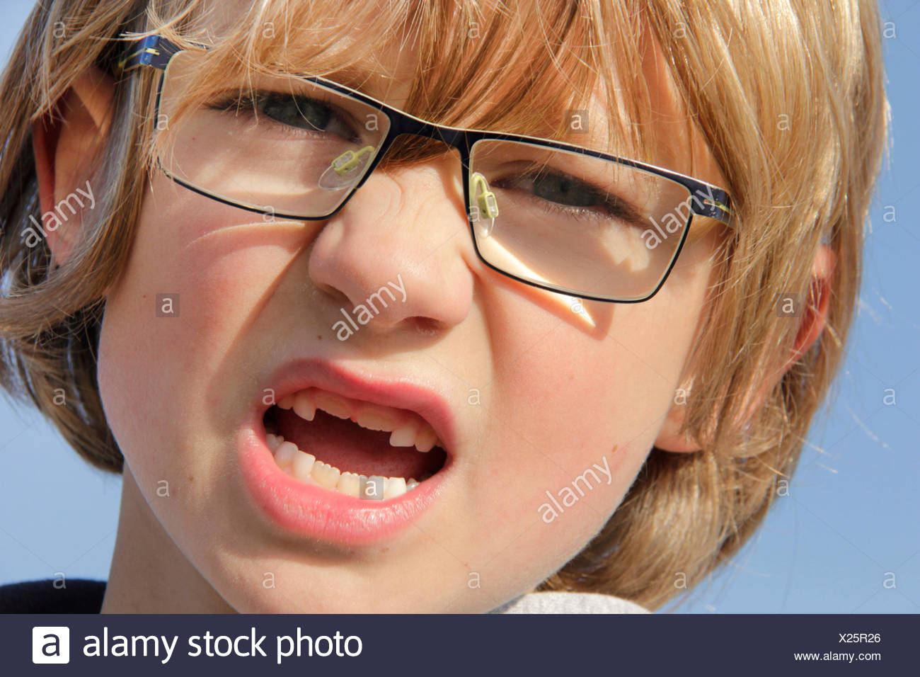 little boy with the second incisors, permanent dentition, portrait of a child - Stock Image