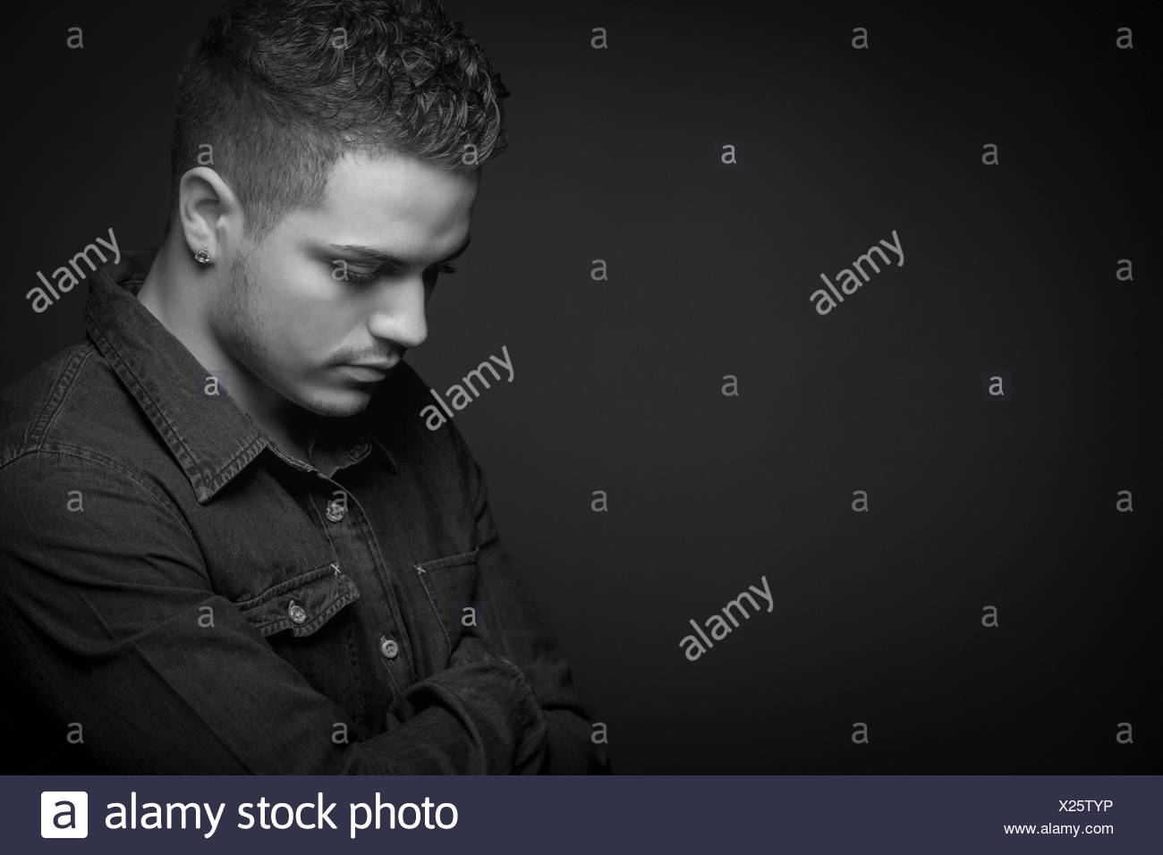 Black and white portrait teenage boy serious sad - Stock Image