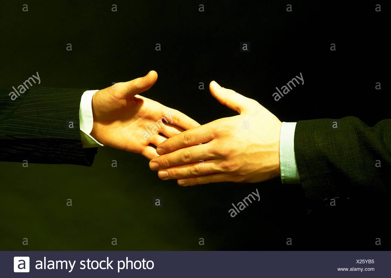 Hands,hand,Merger,union,unite,handshake,business,men,economy - Stock Image
