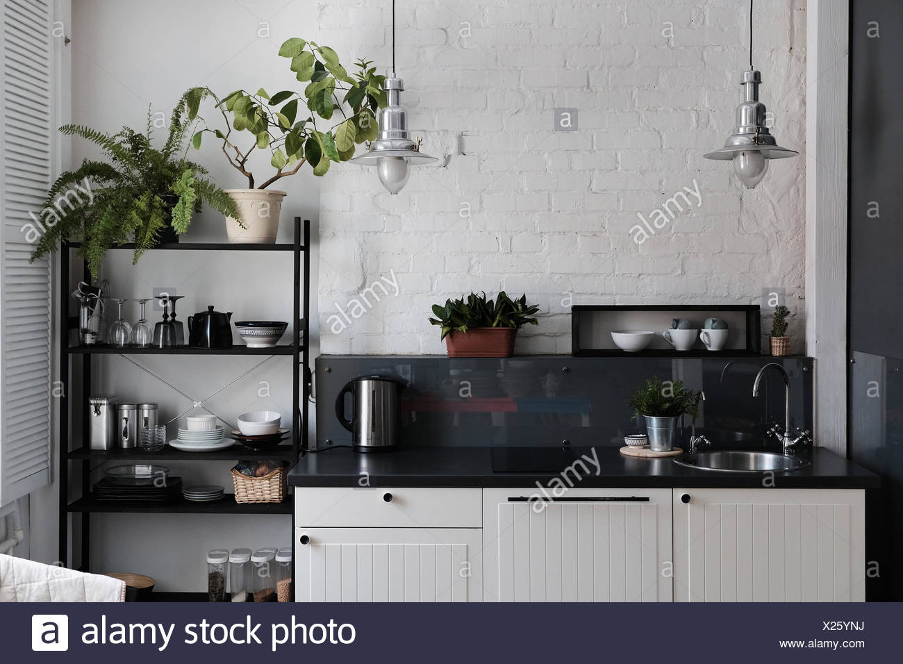 Kitchen with tidy counter and shelves - Stock Image