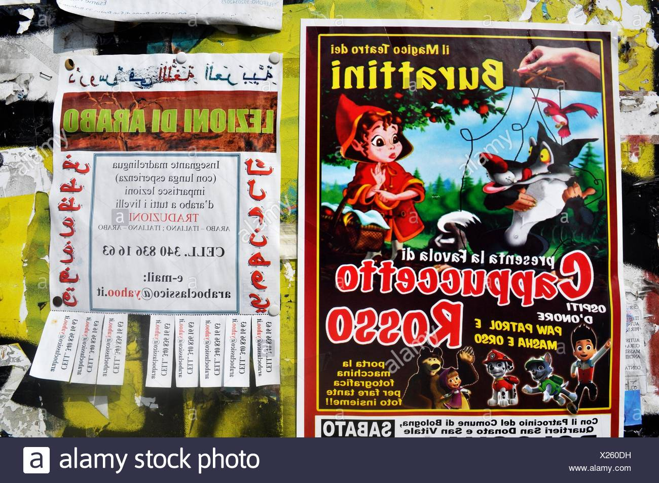 Bologna, Italy: ads for a puppets show and for Arabic classes, side by side - Stock Image
