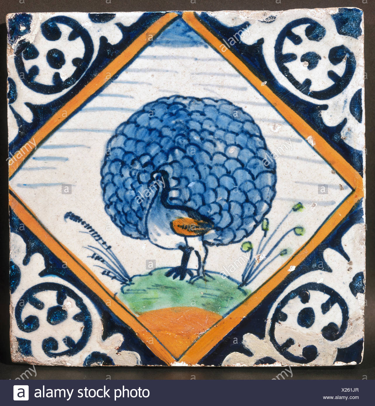 fine arts, decorative tiles, tile with peacock illustration, Delft, early 17th century, 13 x 13 cm, De Porceleyne Fles, Delft, Artist's Copyright has not to be cleared - Stock Image