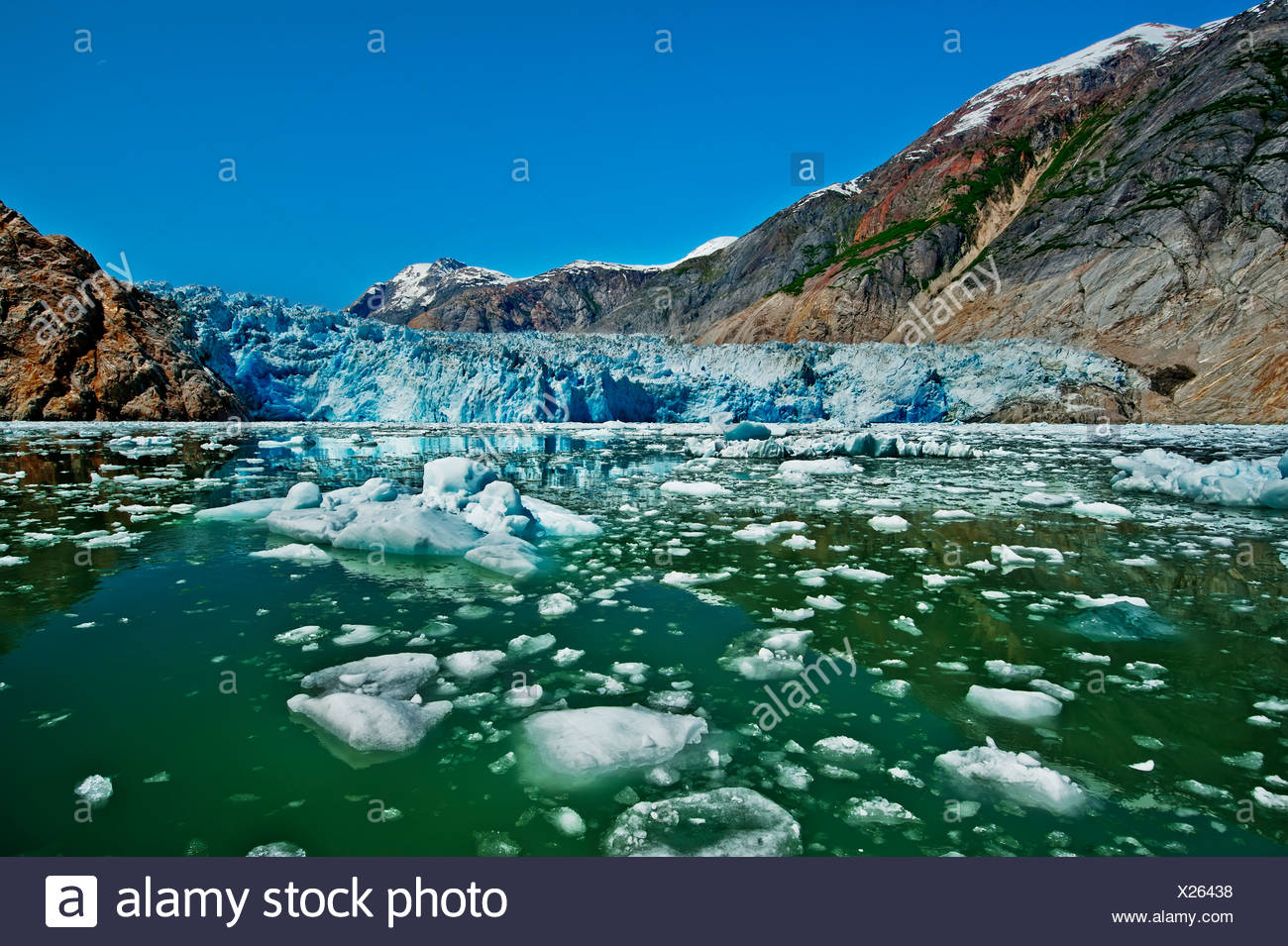 Summer ice bergs float in front of South Sawyer Glacier in Tracy Arm, Tracy Arm-Fords Terror Wilderness, Souhteast Alaska - Stock Image