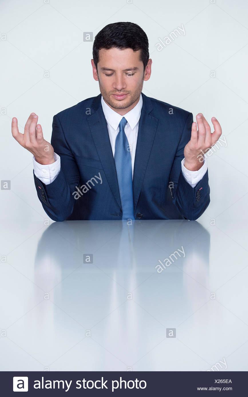 Businessman meditating - Stock Image
