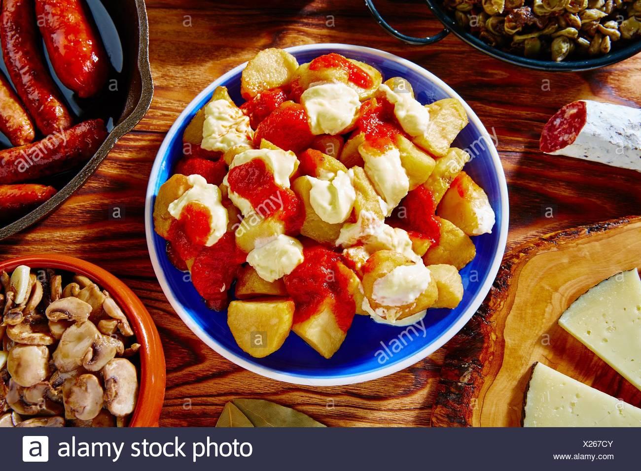 Tapas Patatas Bravas potatoe fries with tomato and mayonaise from Spain. - Stock Image