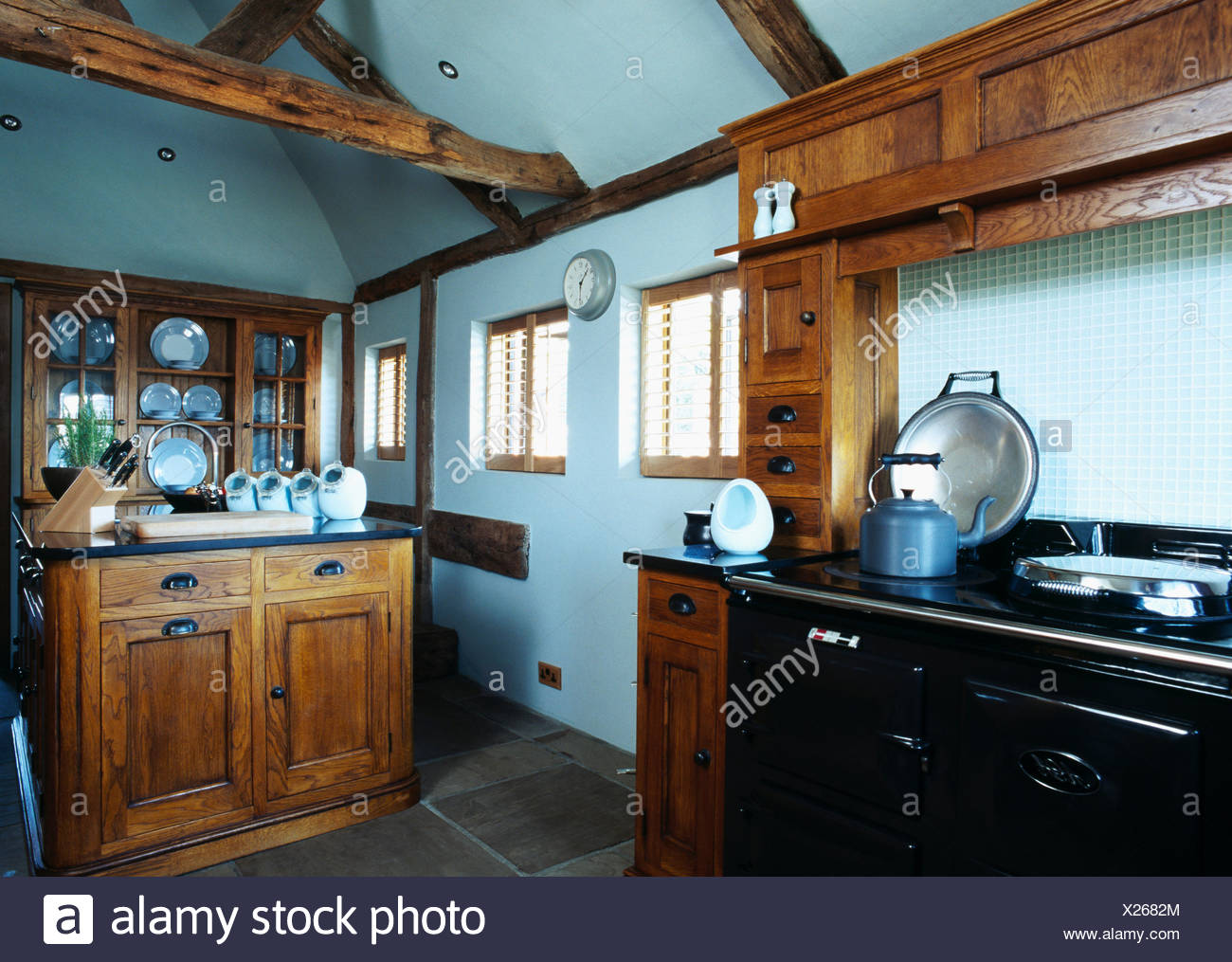 Blue Kettle On Black Aga In Pastel Blue Country Kitchen With ...