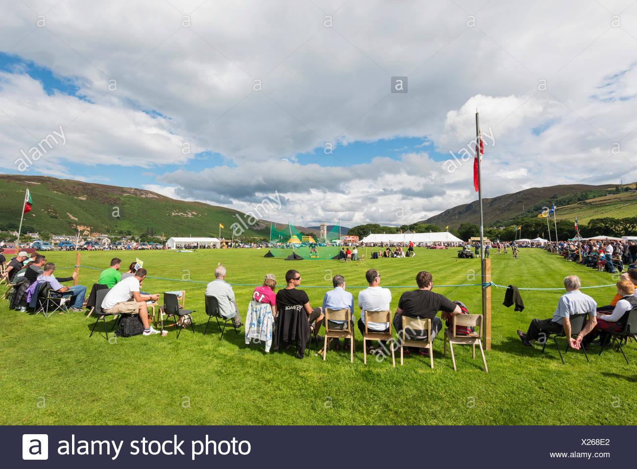 Spectators sitting on the sidelines, Helmsdale Highland Games, Helmsdale, Sutherland, Scotland, United Kingdom, Europe - Stock Image