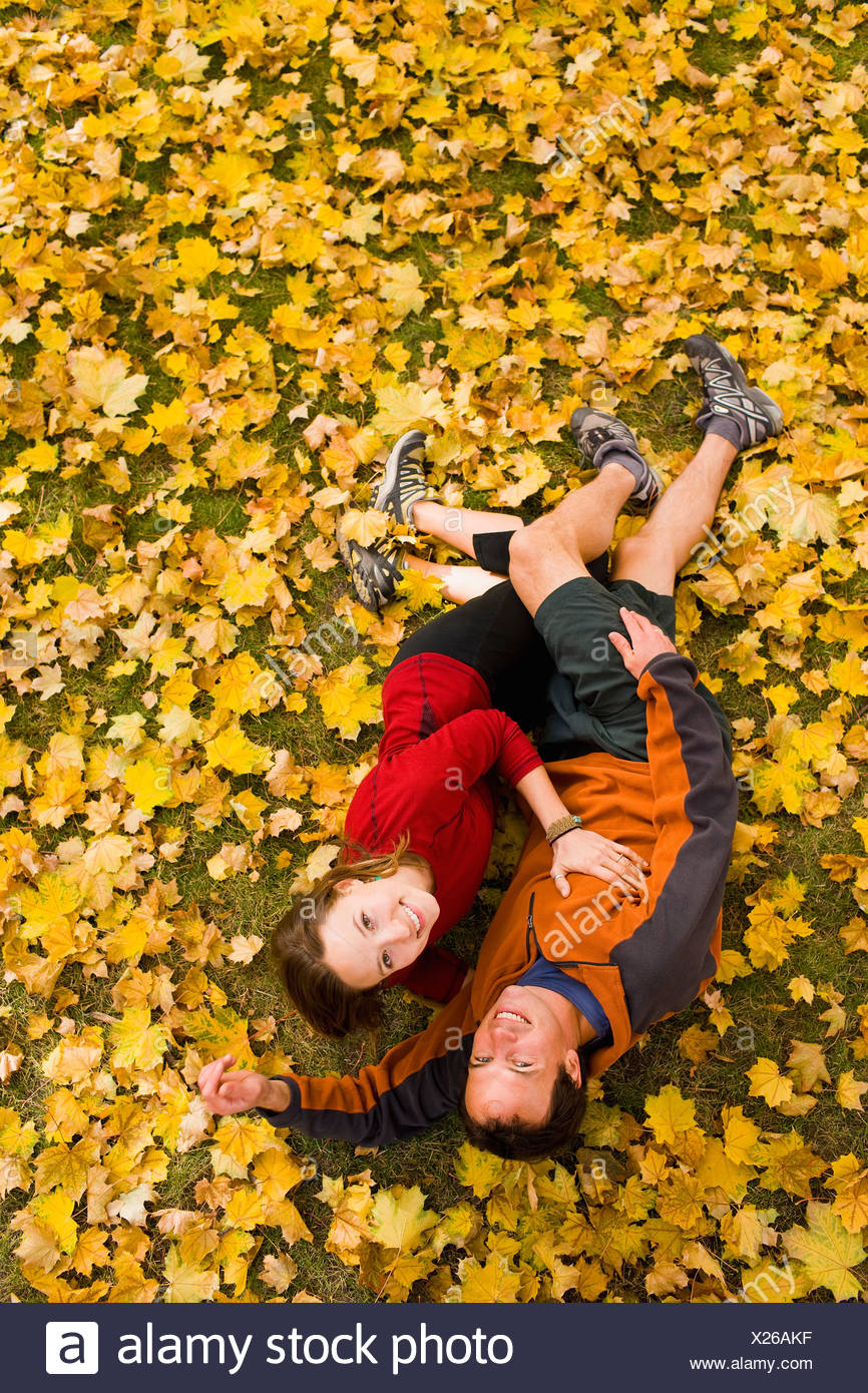 USA, Montana, Kalispell, Happy couple embracing in autumn - Stock Image
