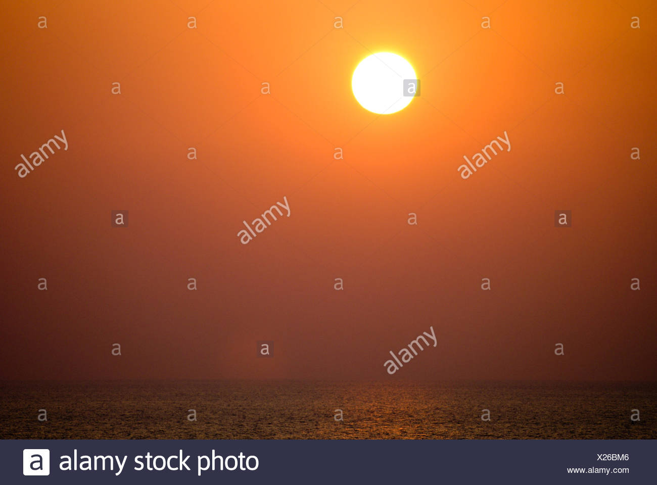 Scenic View Of Sun Over Sea During Sunset - Stock Image