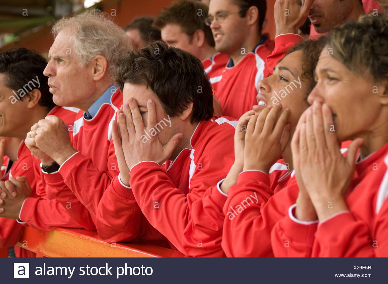 Despairing fans at football match - Stock Image