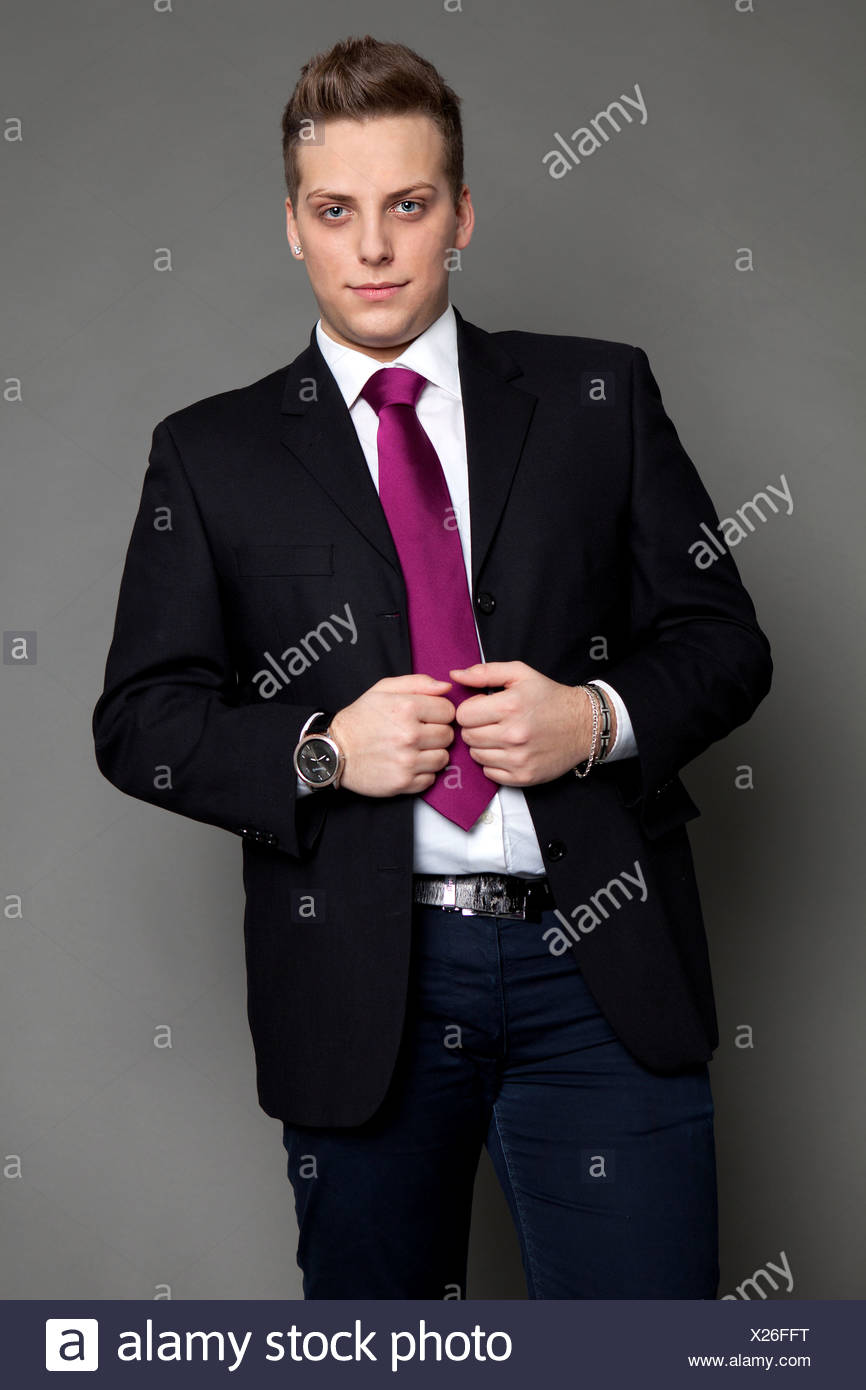 Young man in a suit and a tie, business attire - Stock Image