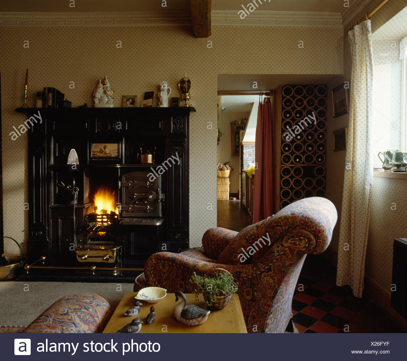 Pink Armchair In Traditional Living Room With Fire Lit In