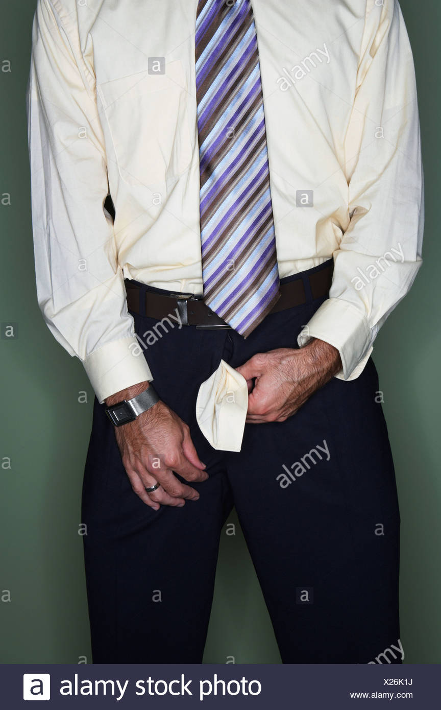 Businessman with his trouser zip undone - Stock Image