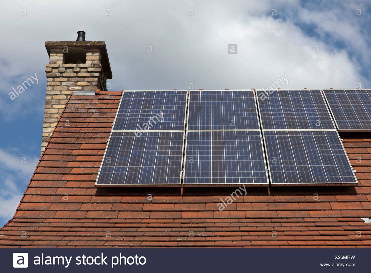 Close up of house roof with solar panels - Stock Image