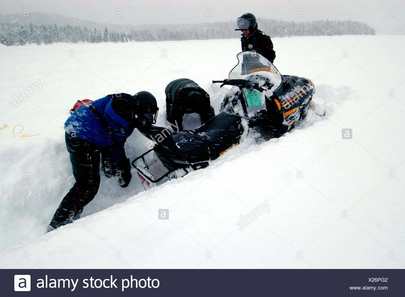 Snowmobile stuck in deep snow, Saguenay-Lac Saint Jean, Mont Valin Region, Quebec, Canada, North America - Stock Image
