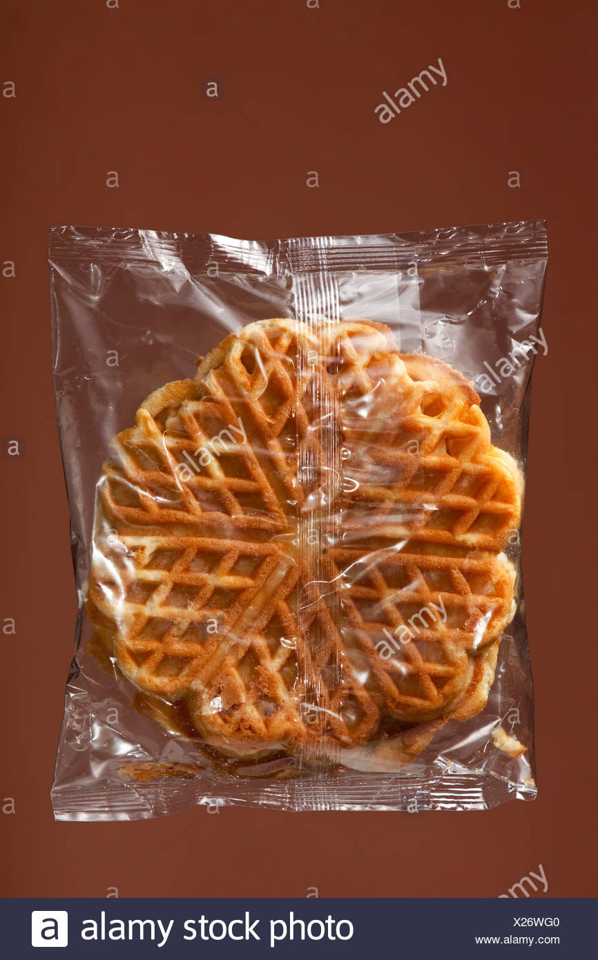Waffles in transparent plastic wrapping - Stock Image