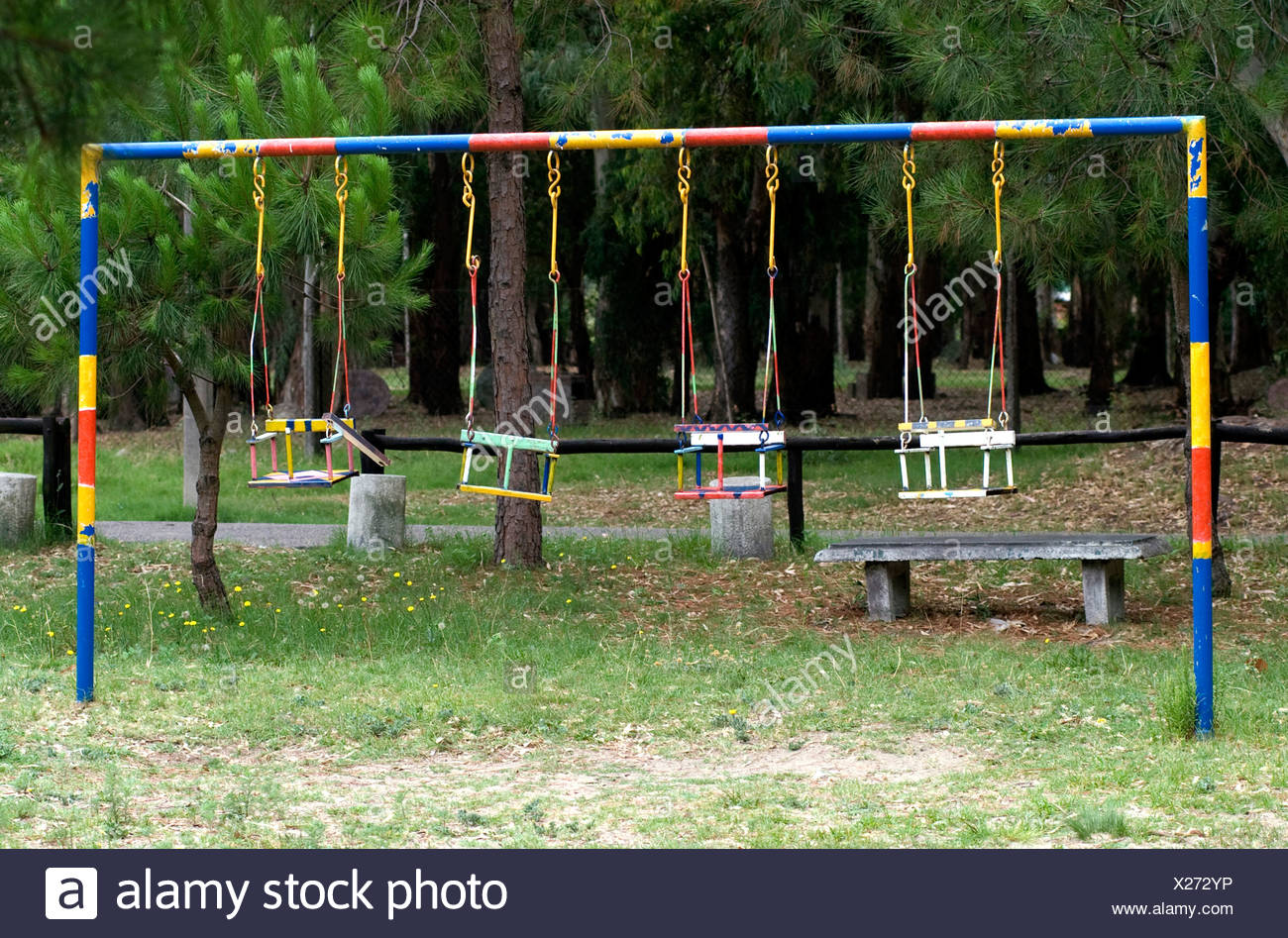 children's' swings in a playground,Uruguay  -  ©Marty Heitner Stock Photo