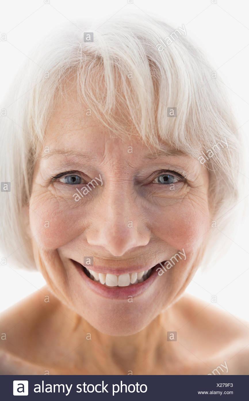 Close up portrait of smiling senior woman - Stock Image