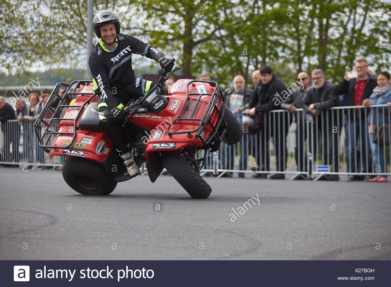 Motorcycle stuntman Mike Auffenberg on a quad bike during the ADAC motorbike startup day, Koblenz, Rhineland-Palatinate, Germany - Stock Image