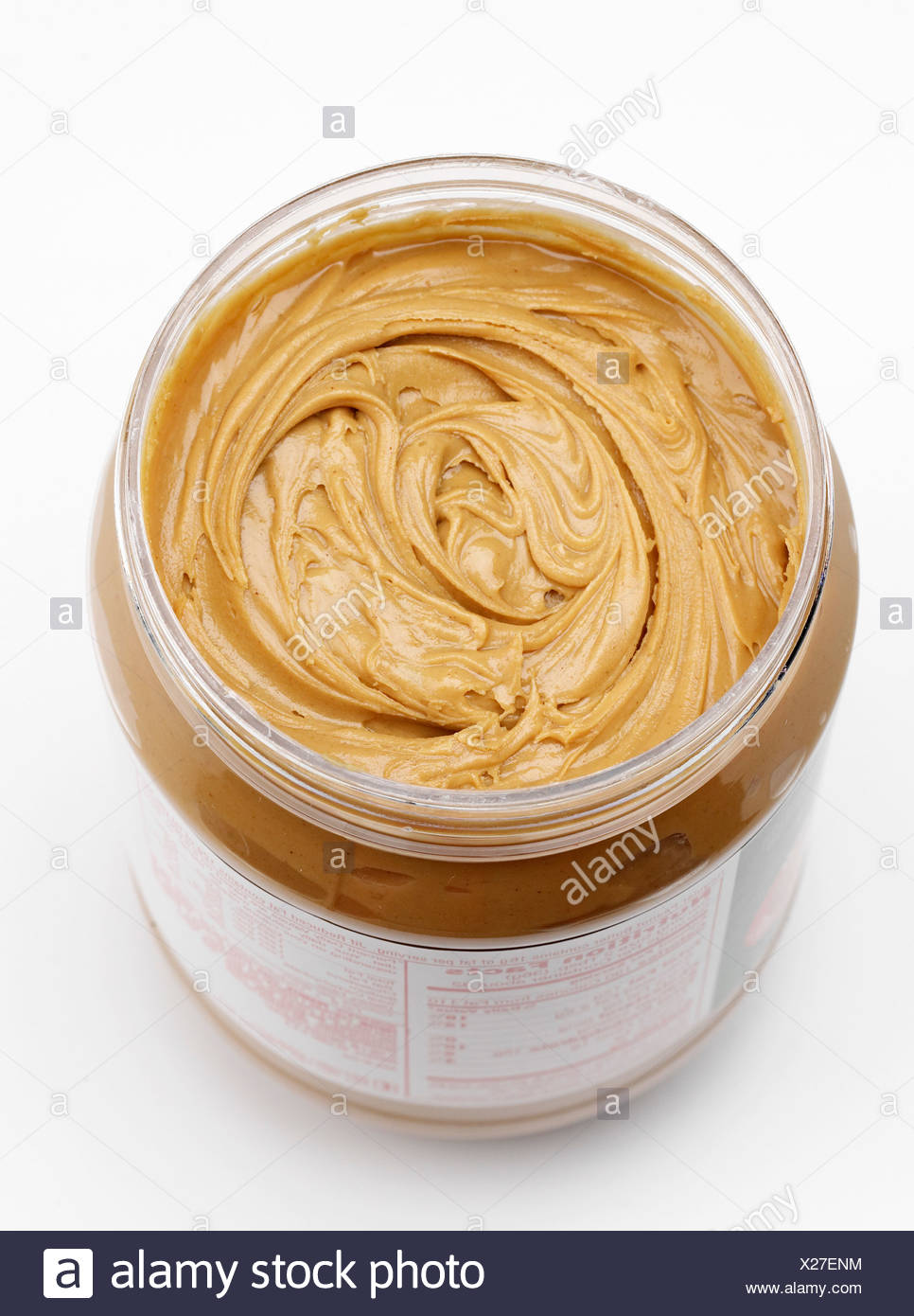 Close up of tub of peanut butter - Stock Image