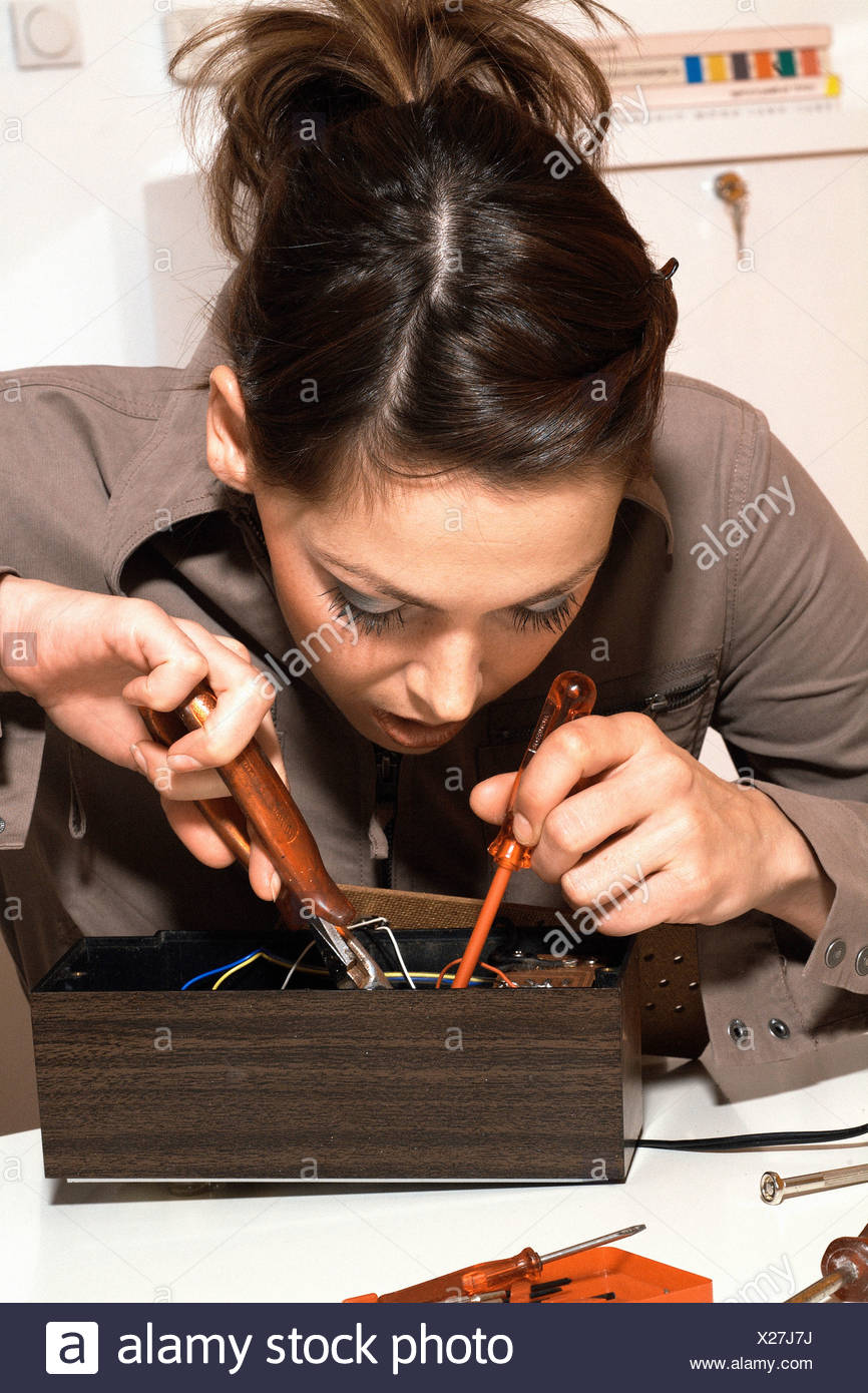 Home Fuse Box Stock Photos Images Alamy Young Woman With Image