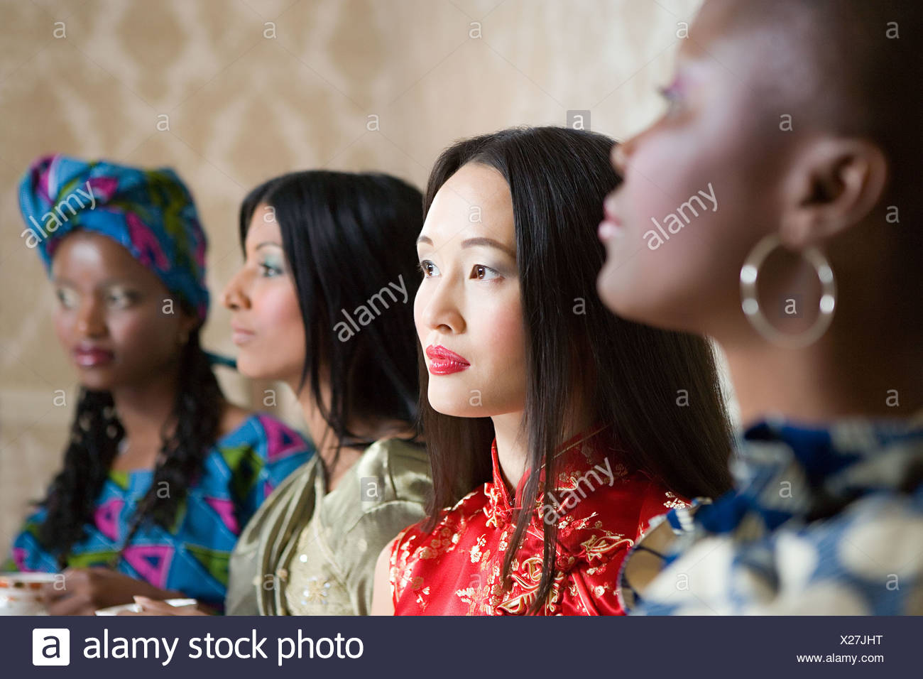 Four women in traditional clothing - Stock Image